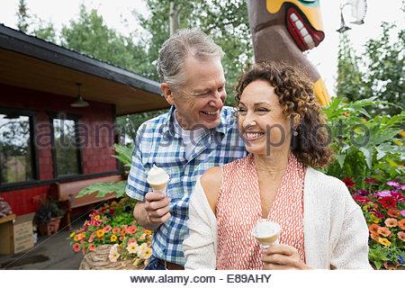 Couple enjoying ice cream cones - Stock Photo