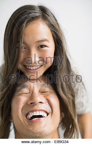 Portrait of father and daughter laughing - Stock Photo