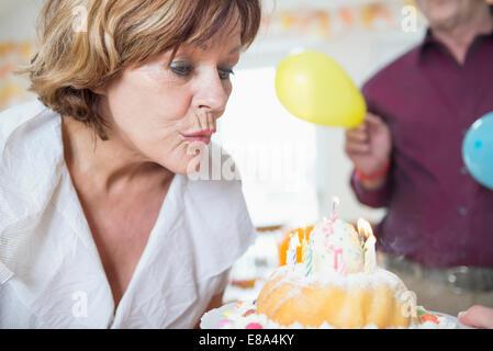 Family celebrating birthday party - Stock Photo