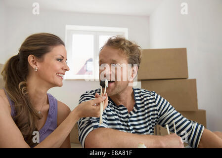 Woman feeding husband sushi lunch eating - Stock Photo