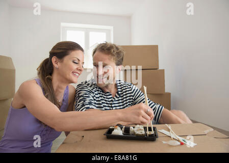 Couple lunch resting eating new apartment - Stock Photo