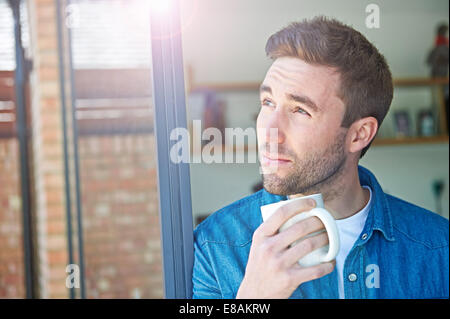 Close up of man with mug - Stock Photo
