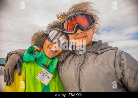 Portrait of children in ski goggles - Stock Photo