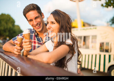 Young couple with ice cream cones - Stock Photo