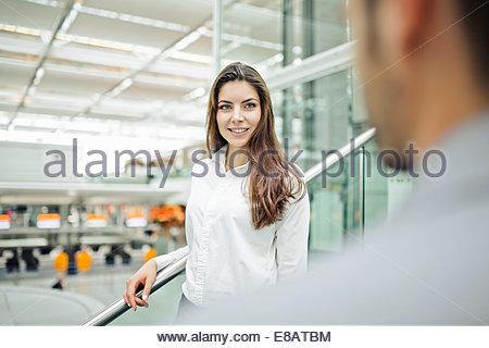 Businesswoman wearing white shirt, smiling - Stock Photo