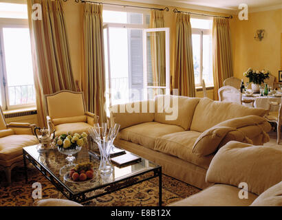 yellow and cream living room sofas and glass topped coffee table with length 18992