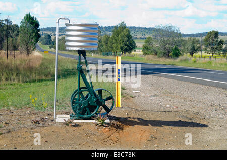 Roadside mailbox using old water pump  fitted with corrugated iron tank - Stockfoto