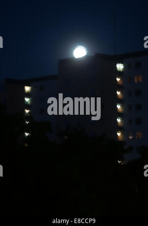 Astigmatic eyesight vision. Seeing double. Dark night shot with full moon with double edges, the way eyes with astigmatic - Stock Photo
