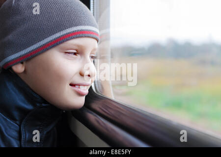 kid cute smile train look window travel - Stock Photo