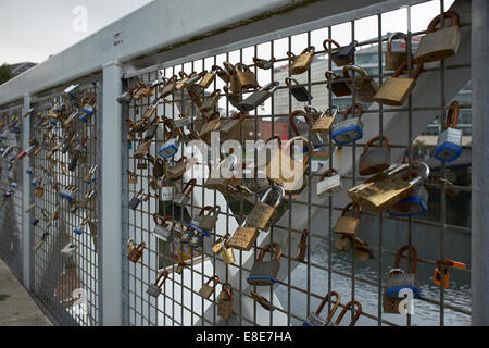 Love locks on the Lagan weir footbridge in Belfast city centre - Stock Photo