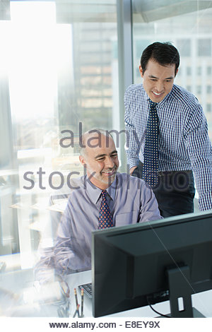 Businessmen working together in office - Stock Photo