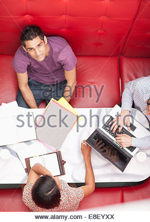 Business people sitting in booth having a meeting - Stock Photo