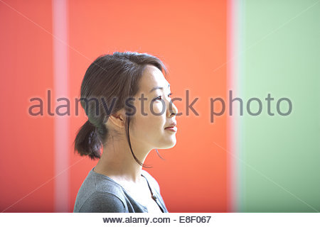 Smiling businesswoman in office - Stock Photo