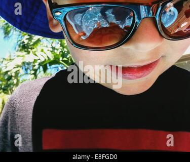 Close up of boy with sunglasses - Stock Photo
