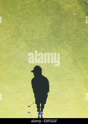 USA, Ohio, Montgomery County, Dayton, Shadow of golf player on golf course - Stock Photo