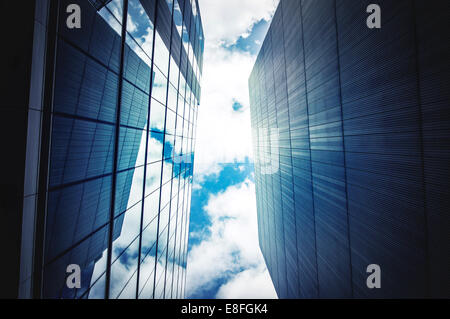 Office buildings with sky and clouds - Stock Photo