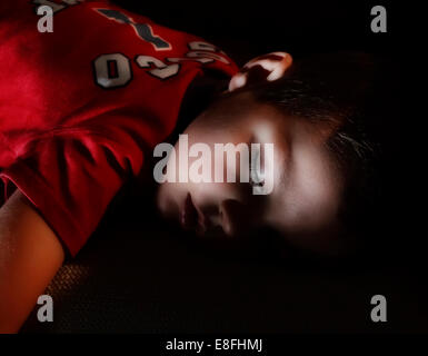 Spain, Boy (2-3) sleeping - Stock Photo