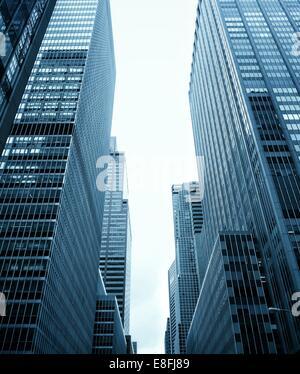 Low angle view of Skyscrapers, Midtown, Manhattan, New York, America, USA - Stock Photo