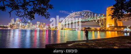 Australia, New South Wales, Sydney, Illuminated cityscape at twilight - Stock Photo