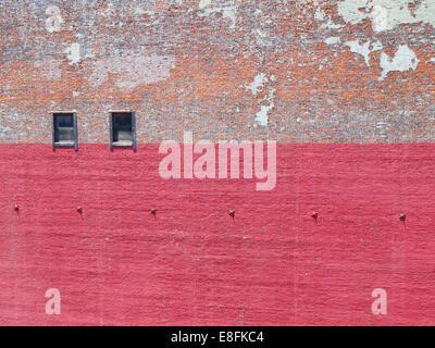 Brick wall with peeling paint - Stock Photo
