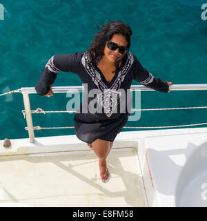 Overhead View Of A Woman standing On deck of A Boat, Caribbean - Stock Photo