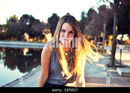 Portrait of young woman outdoors - Stock Photo