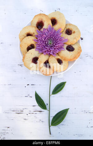 Plate of biscuits decorated to look like flower - Stock Photo