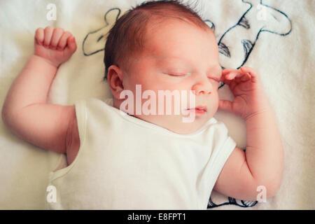 Overhead view of newborn baby boy sleeping - Stock Photo