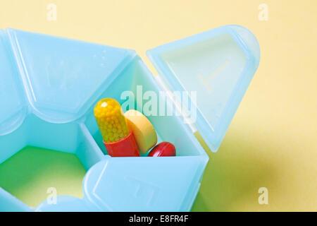 Pills in pill box - Stock Photo