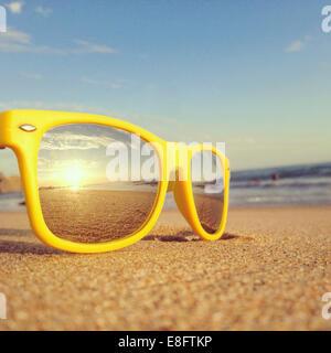 Beach reflection in sunglasses - Stock Photo