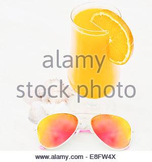 Orange Juice and sunglasses - Stock Photo