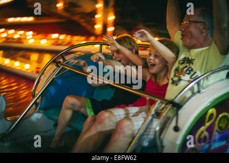 USA, New Jersey, Cape May County, Ocean City, Family on amusement park ride - Stock Photo