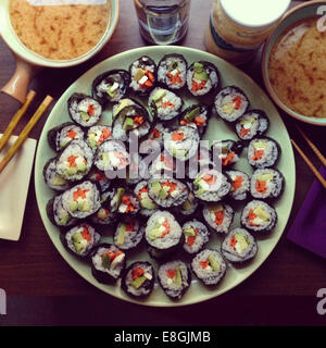 Homemade vegetarian sushi with miso soup - Stock Photo
