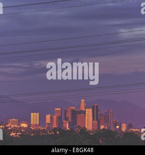 USA, California, Los Angeles County, Los Angeles, View of city through power lines - Stock Photo