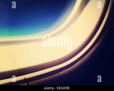 Part of window in airplane cabin - Stock Photo