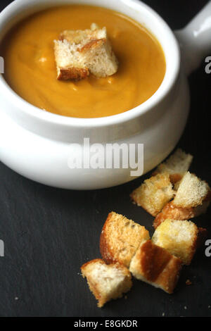 Creamy Pumpkin Soup with croutons - Stock Photo