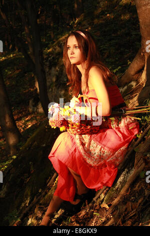 Girl (12-13) with Basket of Flowers - Stock Photo
