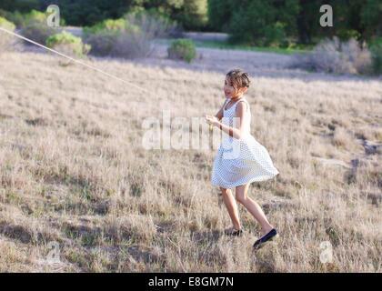 Girl flying kite - Stock Photo