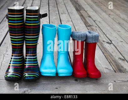Three pairs of a colorful rain boots. Family concept - Stock Photo