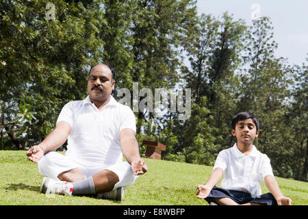 1 Indian Man Exercising in Parks with kid - Stock Photo