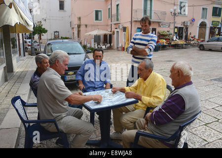 Men playing cards in Rodi's square, Gargano, Puglia, Italy - Stock Photo