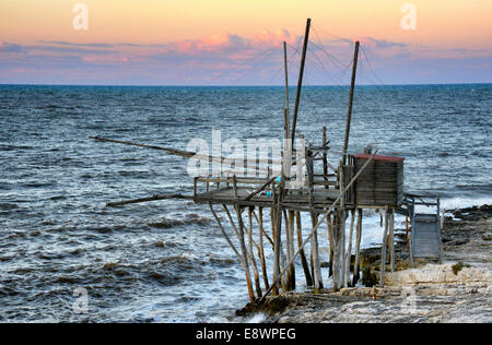 A Trabucco, which is a historic fishing platform, can be found on the Gargano coastline of Italy. - Stock Photo