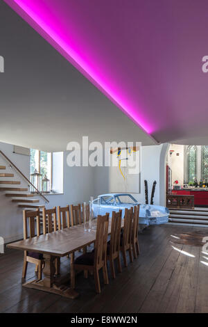 Modern Split Level Dining Room With Steps Up To Kitchen