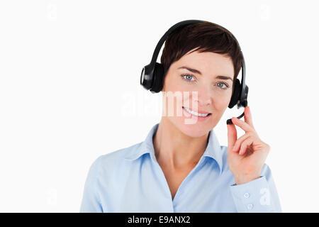 Close up of a secretary using a headset - Stockfoto