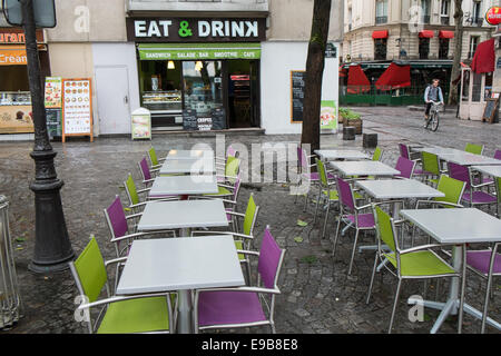 An empty cafe/restaurant just prior to lunch-time on a showery June day near Georges Pompidou Centre, Paris, France. - Stock Photo