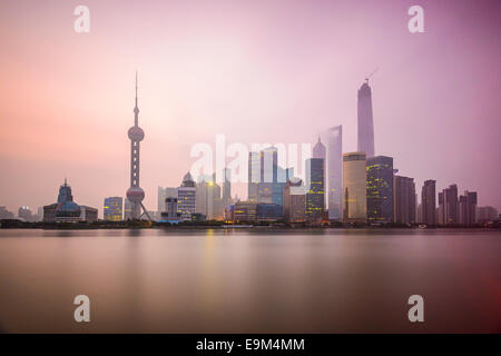 Shanghai, China city skyline on the Huangpu River. - Stock Photo