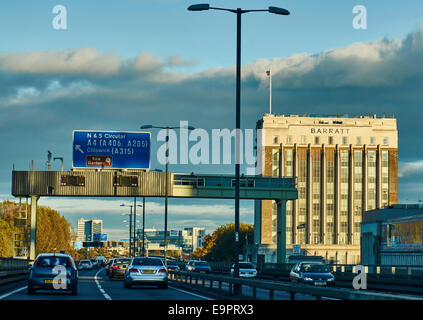 The historic Barratt building in Brentford, bathed in warm early evening sunshine, taken from M4 motorway near the - Stock Photo