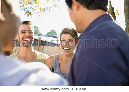 Friends laughing and talking - Stockfoto
