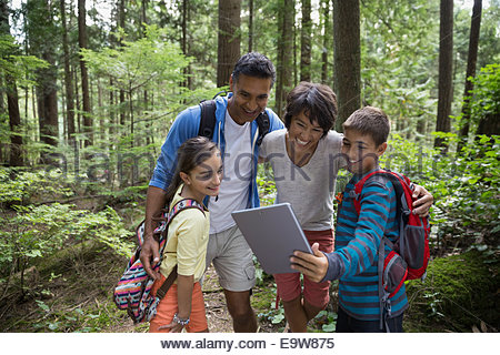 Family taking selfie with digital tablet in woods - Stockfoto