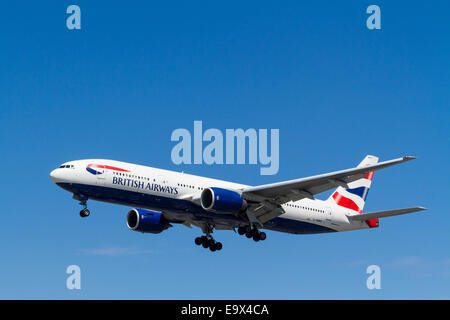 British Airways Boeing 777, G-YMMU, on landing approach at London Heathrow, England, UK - Stock Photo
